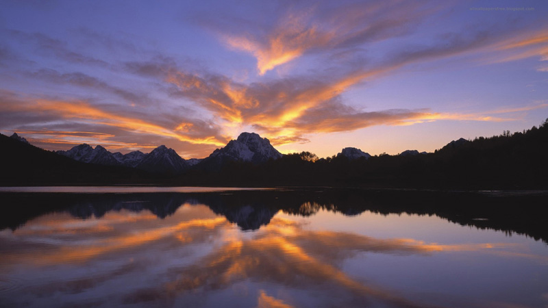 solnedgång-över-berg