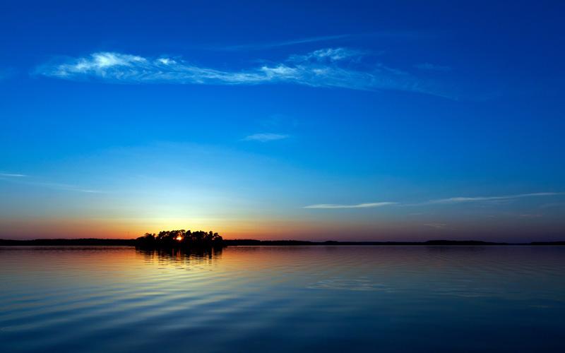 solnedgång-över-sjö